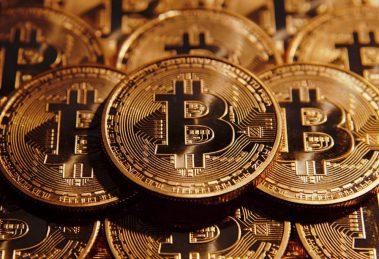 Trois pièces de Bitcoin